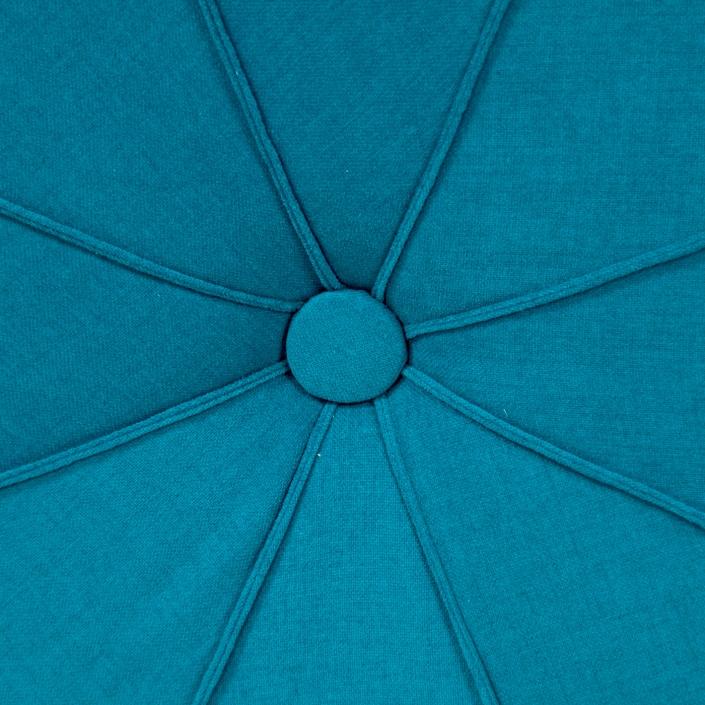 Zdjęcie produktu puf niebieski obity tkaniną zbliżenie